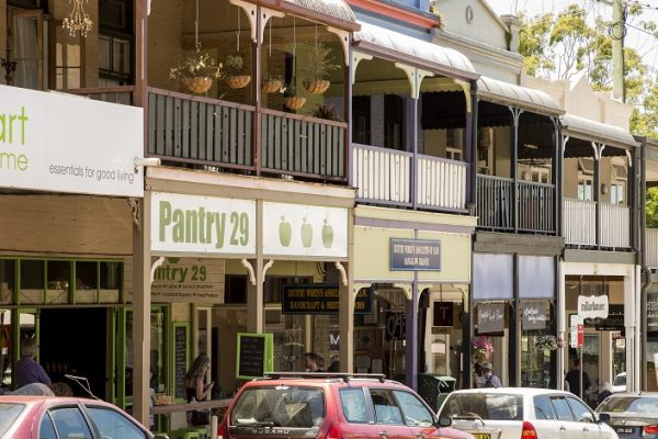 Bangalow Village main street lined with retail stores.